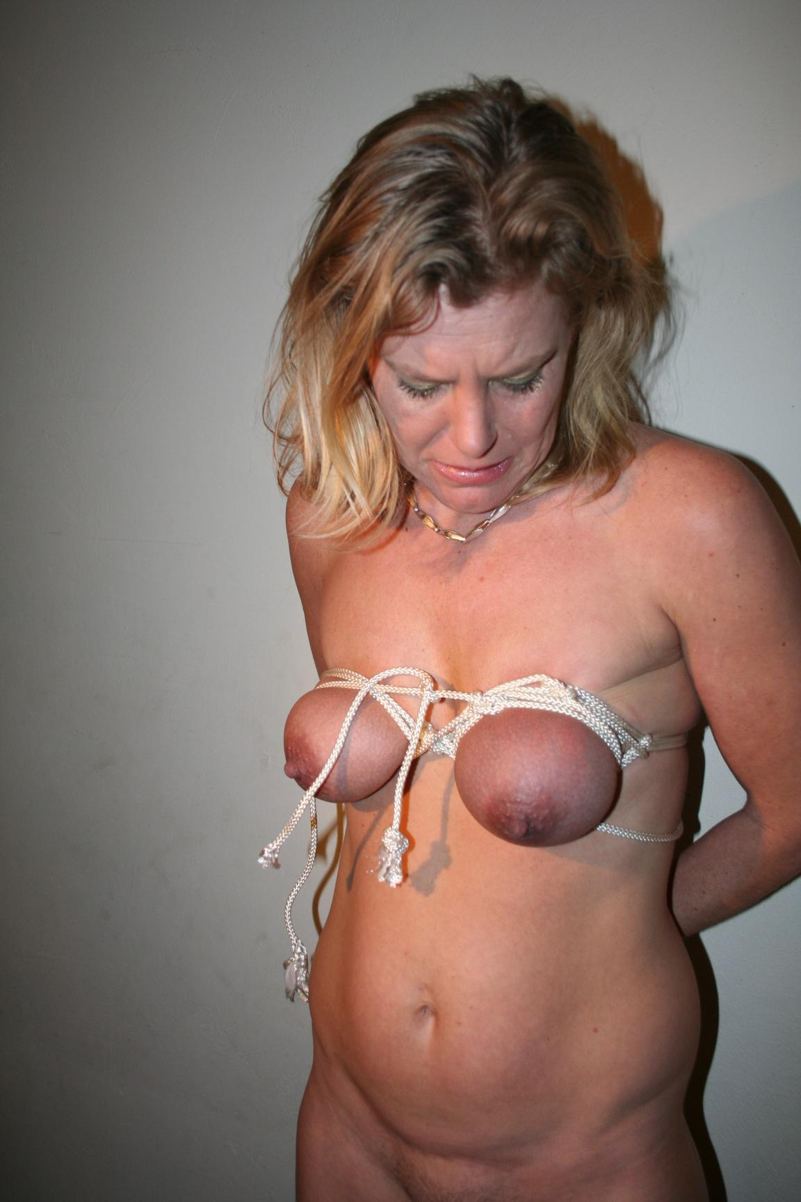 Tied up blonde flogged on the floor 6